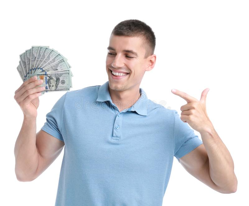 Handsome young man with dollars. On white background stock photography