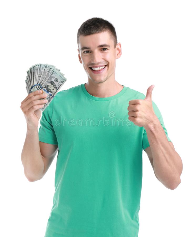 Handsome young man with dollars on  background. Handsome young man with dollars on white background royalty free stock photo