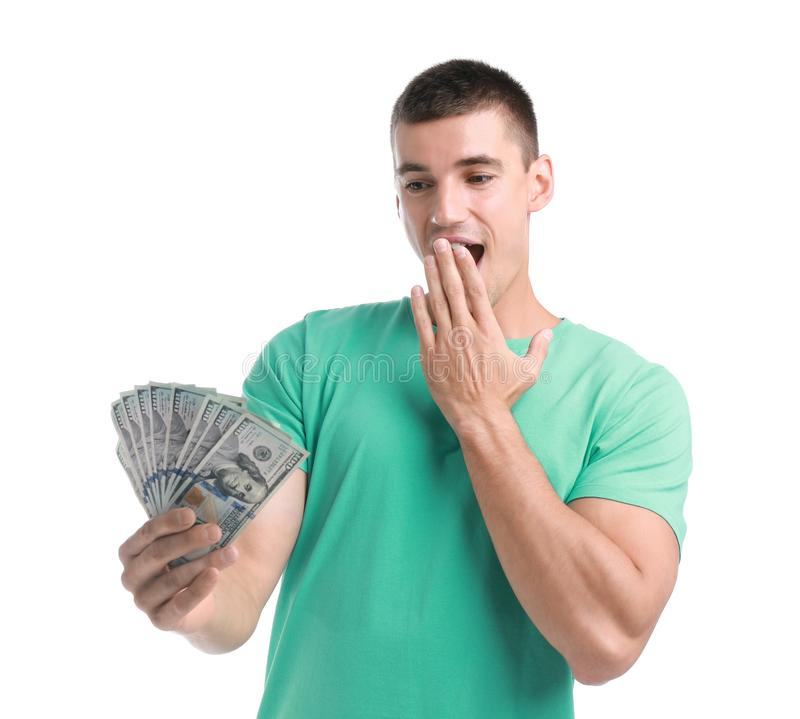 Handsome young man with  on white background. Handsome young man with dollars on white background stock photos