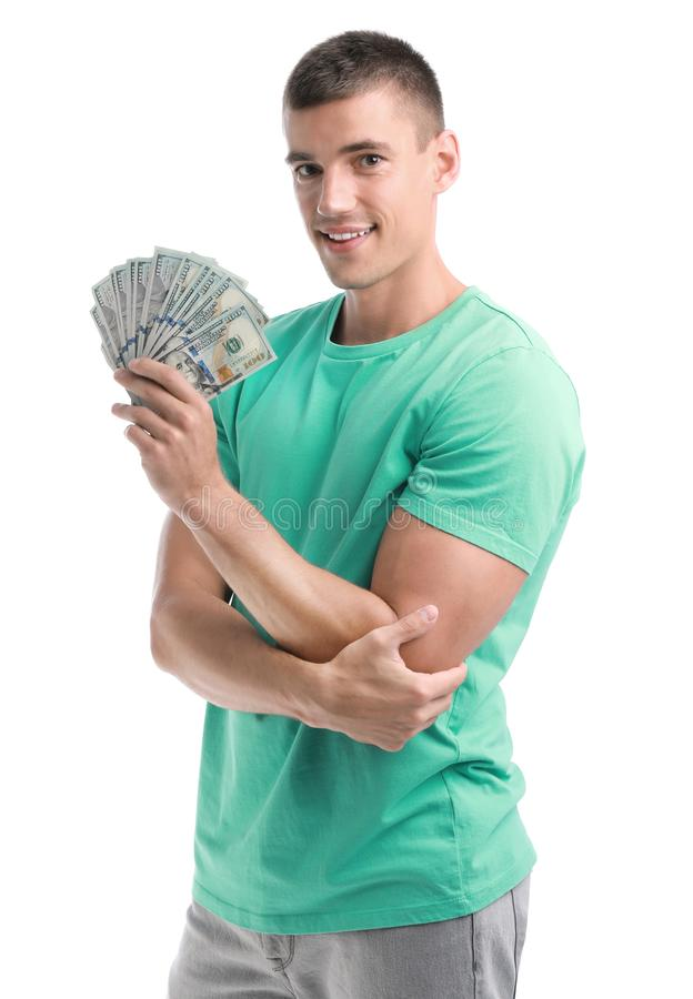 Handsome young man with dollars. On white background stock image