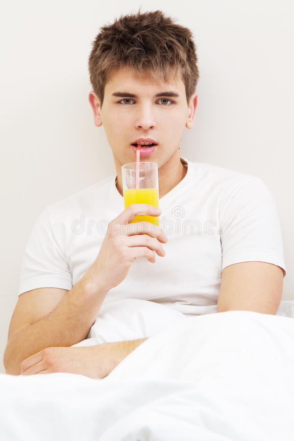 Download Handsome Young Man Drinking Juice Stock Photo - Image: 23946458