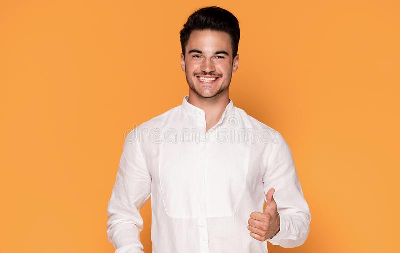 Handsome young man in elegant fashionable clothes stock photo
