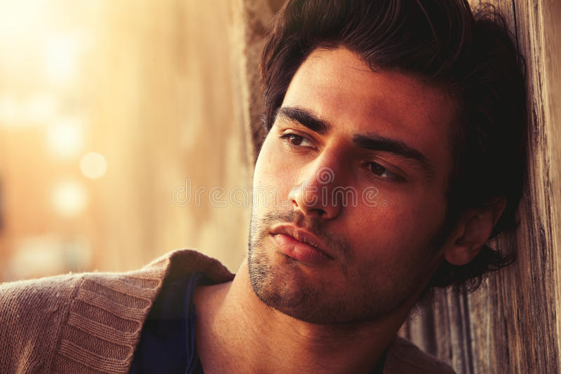 Handsome young man emotion. Warm harmony portrait stock photo