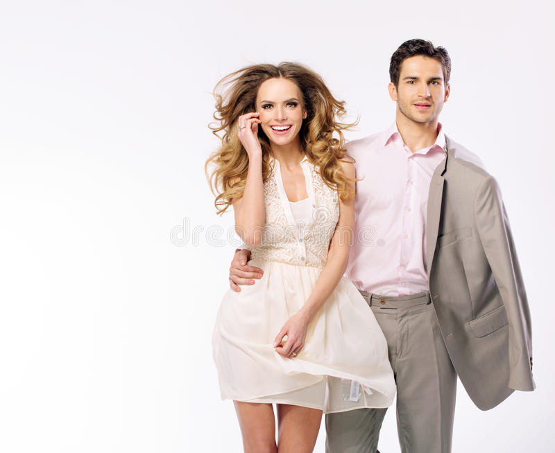 Handsome young man with fabulous and cheerful girlfriend stock images