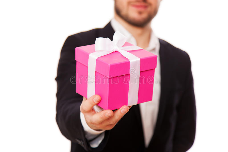 Handsome young man with a gift box.  royalty free stock image