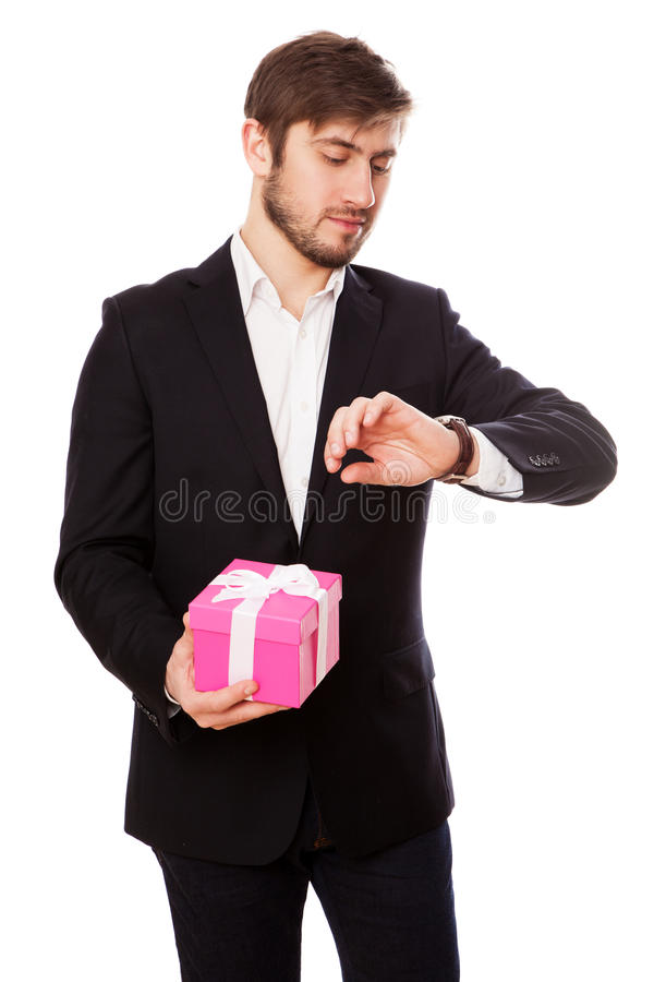 Handsome young man with a gift box.  stock photos