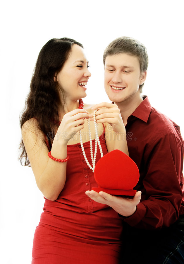 Handsome Young Man Gives A Present To His Wife Stock Photo