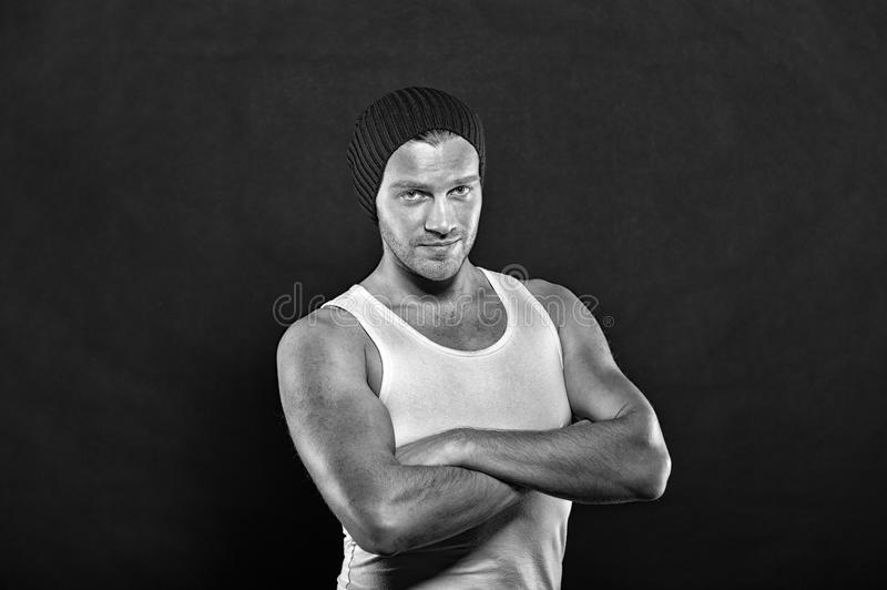 Handsome young man in hat, muscular guy portrait royalty free stock photo