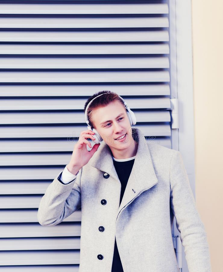 Handsome young man in headphones stock image