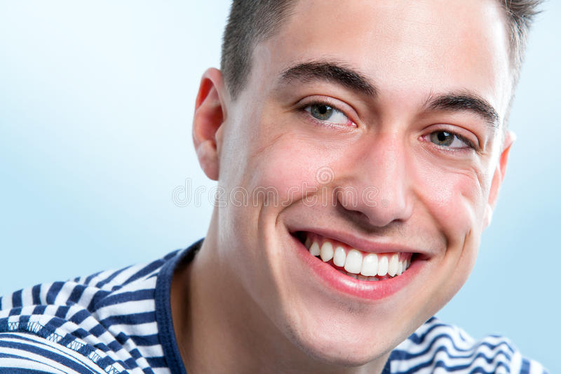 Handsome young man with healthy teeth looking aside. royalty free stock photo