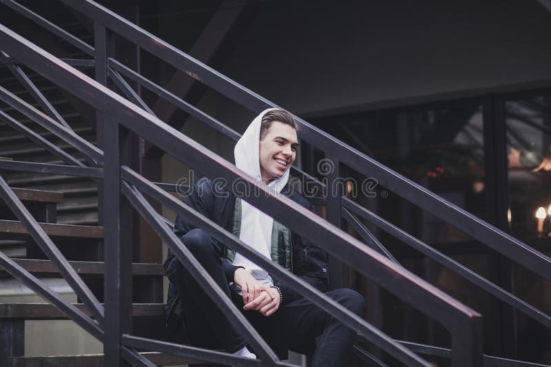 Handsome young man hipster in jacket royalty free stock photo