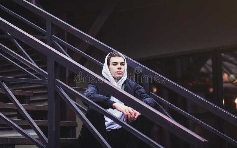 Handsome young man hipster in a trendy jacket stock photos