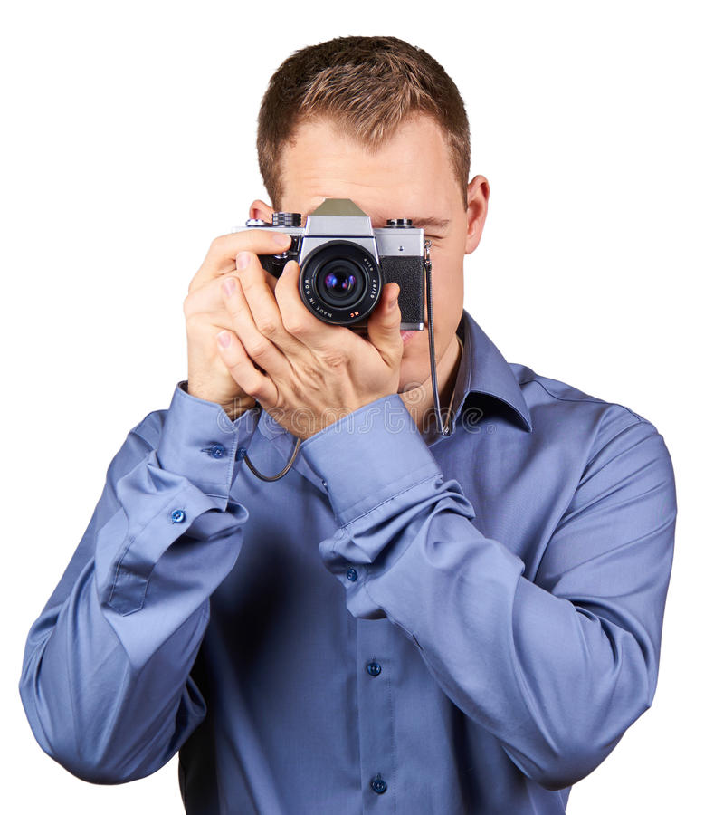 Handsome young man holding a vintage camera. Isolated. Handsome young man holding a DSLR camera. On white royalty free stock photos
