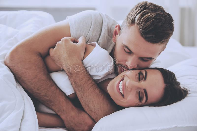 Handsome Young Man Hugging His Beautiful Wife stock image