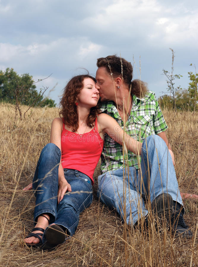 Handsome young man kissing his girlfriend royalty free stock images