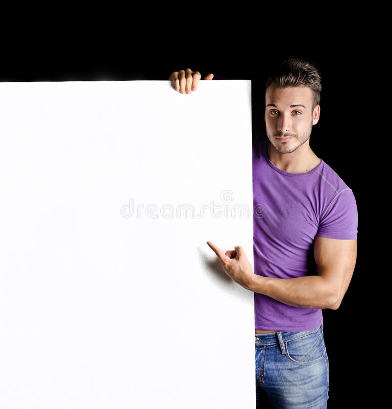 Handsome young man with large blank display stock photos