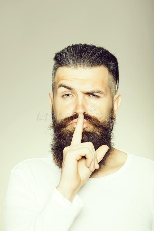 Bearded man with hush gesture stock image