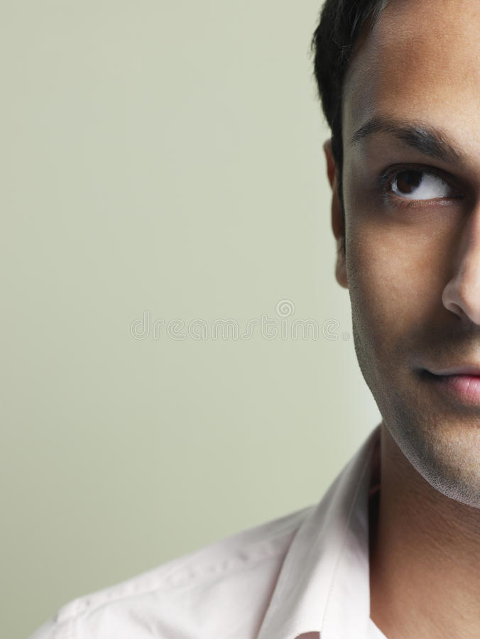 Handsome Young Man Looking Up. Closeup of handsome young man looking up on colored background stock photography