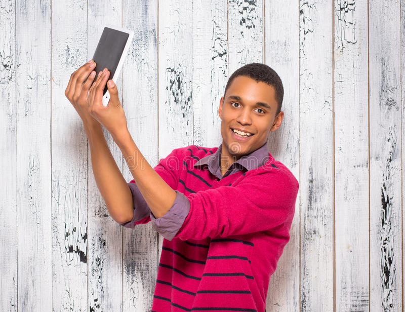 Handsome young man making selfies in studio royalty free stock photography