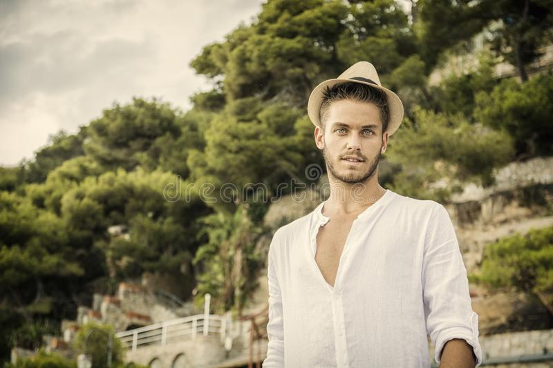 Handsome young man in nature in summer day stock image