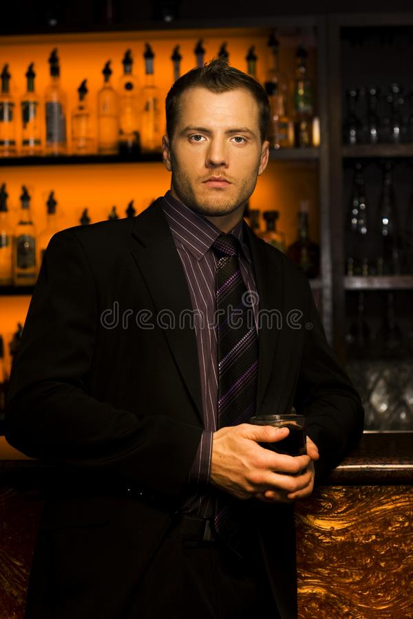 Handsome Young Man At Nightclub Bar Stock Photography