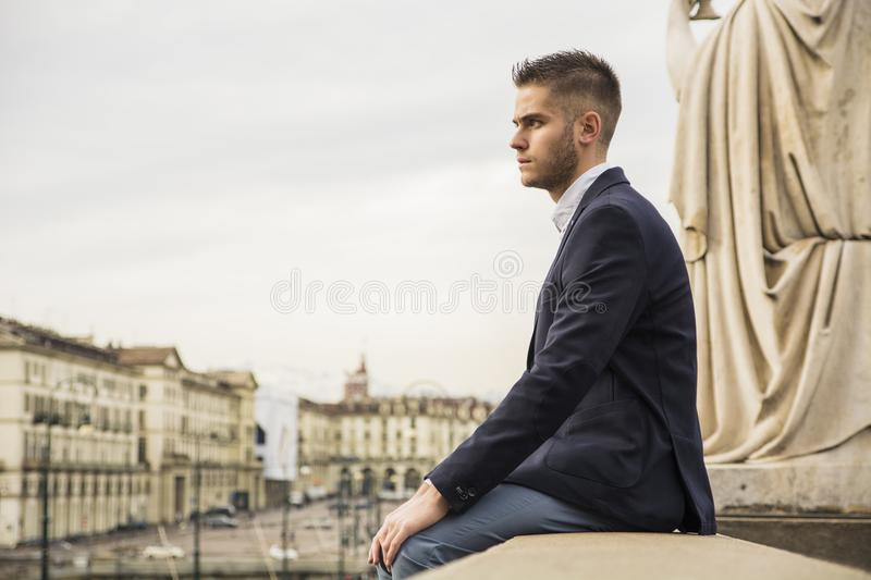 Handsome young man outdoor in jacket and shirt stock photography