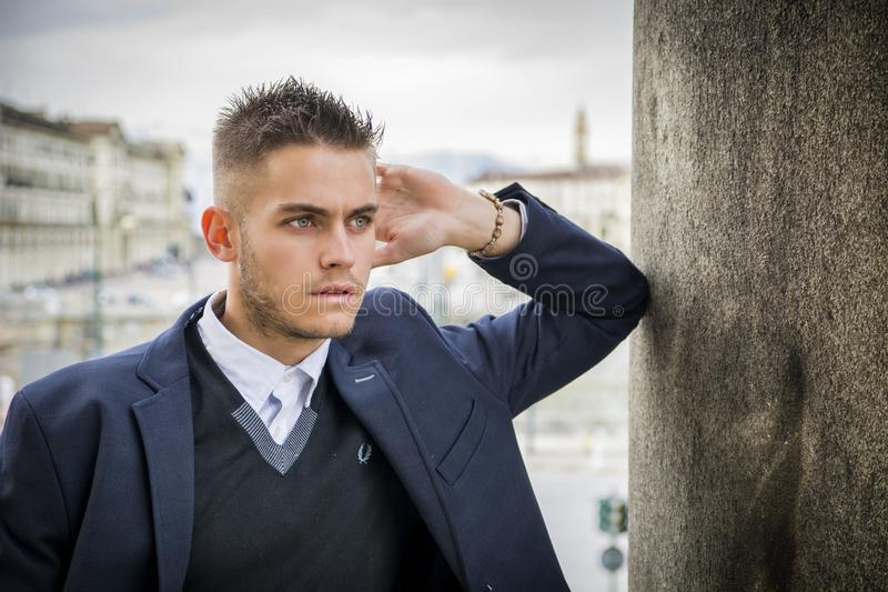 Handsome young man outdoor in jacket and shirt royalty free stock photos