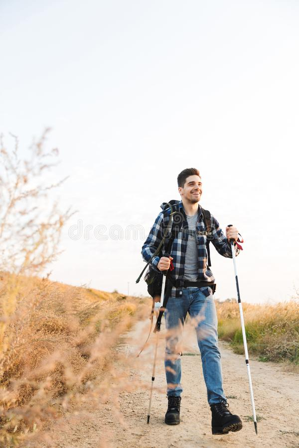 Handsome young man outside in free alternative vacation camping royalty free stock image