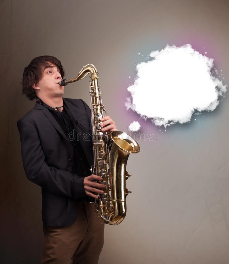 Young man playing on saxophone with copy space in white cloud stock photos