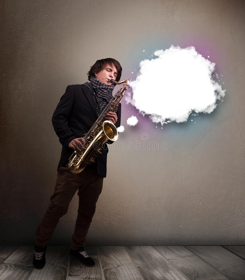 Young man playing on saxophone with copy space in white cloud stock photography