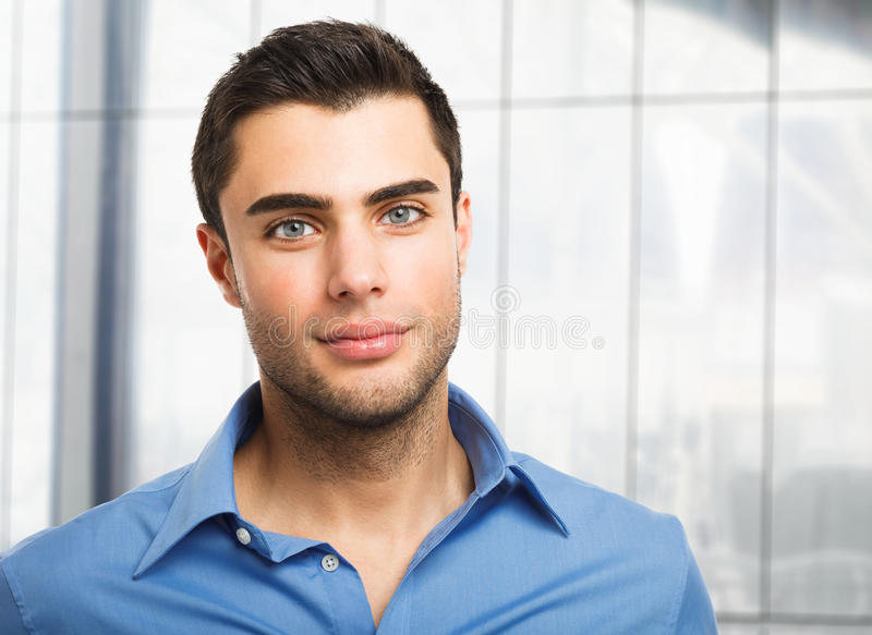 Download Handsome Young Man Portrait Stock Photo - Image of confident, work: 28669830