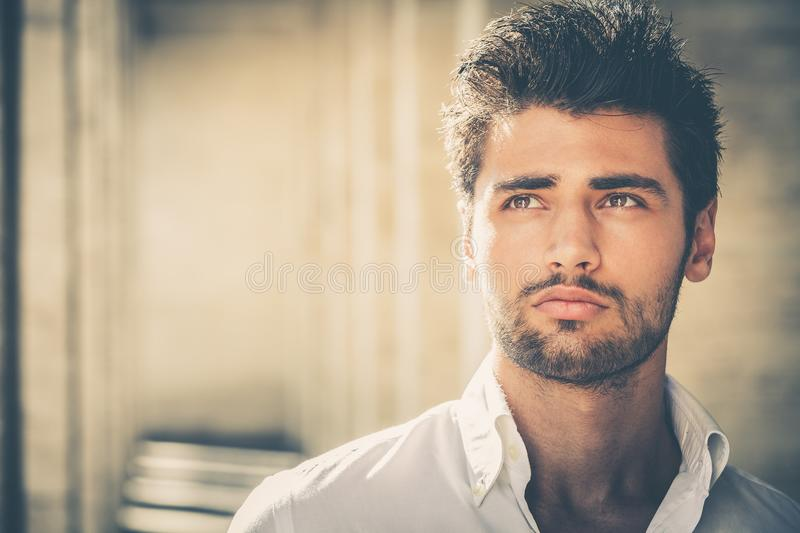 Handsome young man portrait. Intense look and eye-catching beauty royalty free stock photography