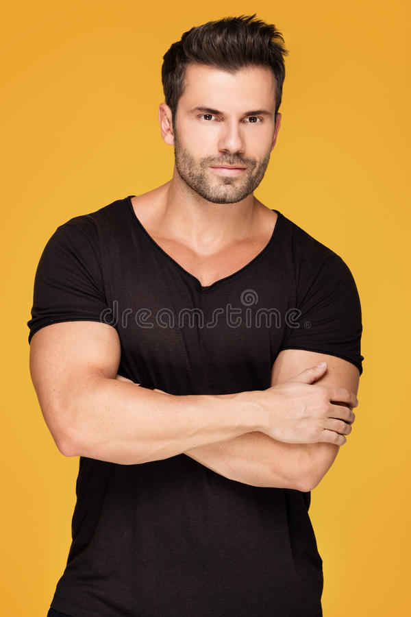 Handsome young man posing in studio. royalty free stock photos