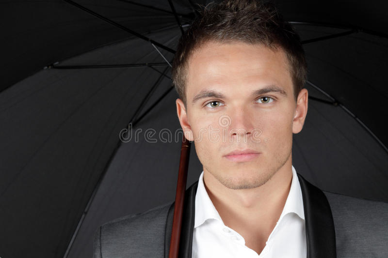 Handsome Young Man Protecting Himself With Umbrell Stock Photo