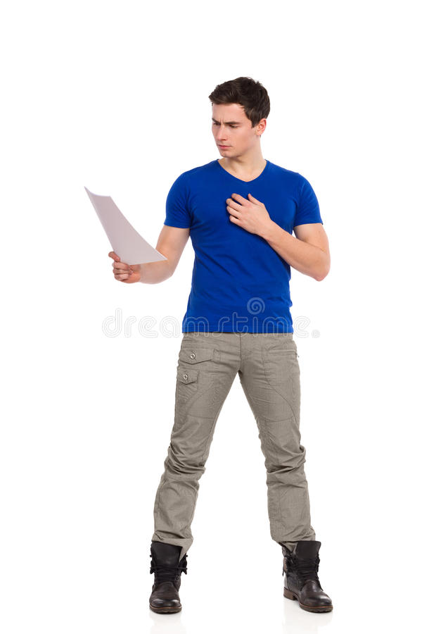 Handsome young man reading document. stock photography