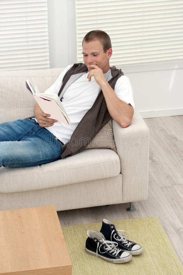 Download Handsome Young Man Reading Good Book Stock Image - Image of handsome, indoors: 11523127
