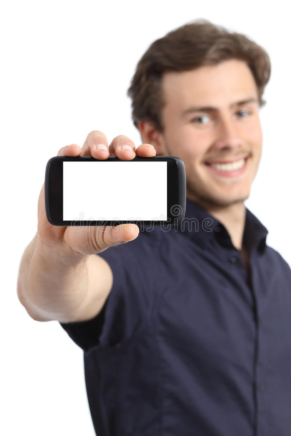 Handsome young man showing a blank smart phone display royalty free stock image