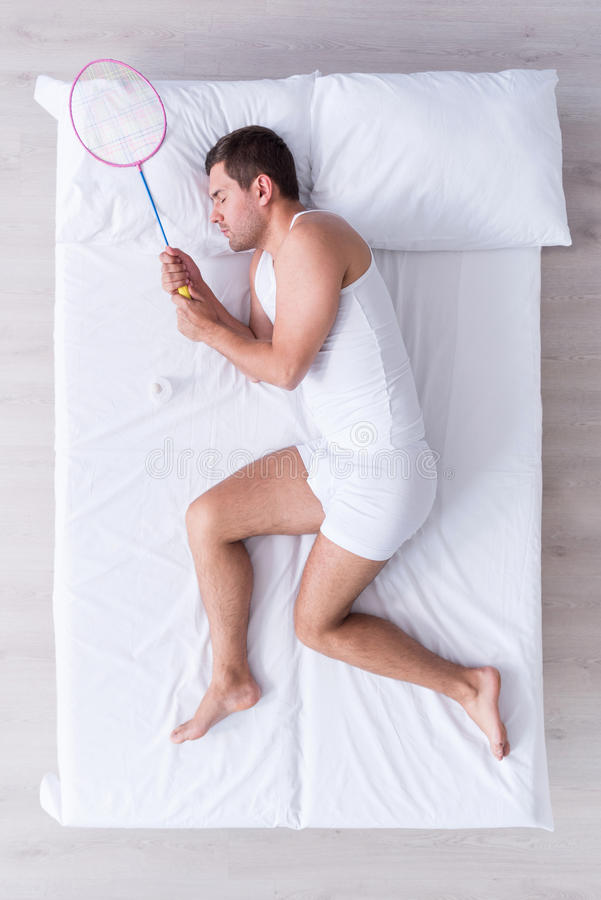 Handsome young man sleeping on bed royalty free stock photos