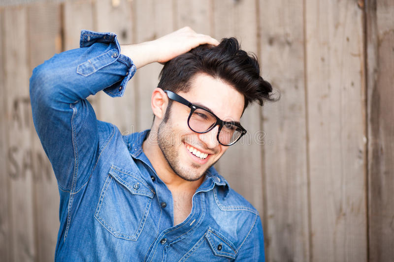 Handsome young man smiling outdoors stock images