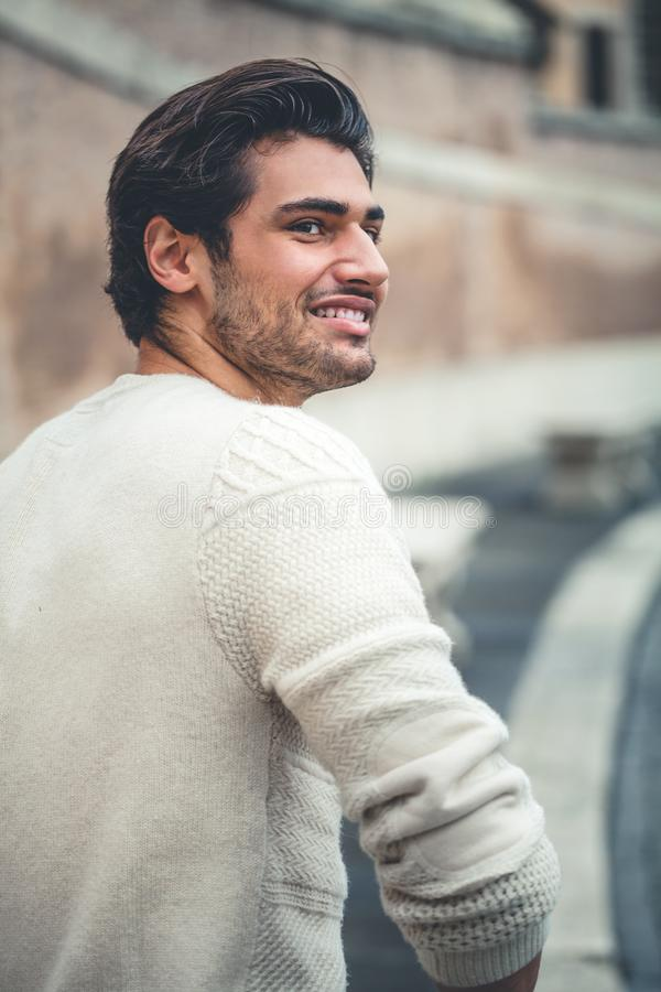 Handsome young man smiling, outdoors. Urban style. stock photos