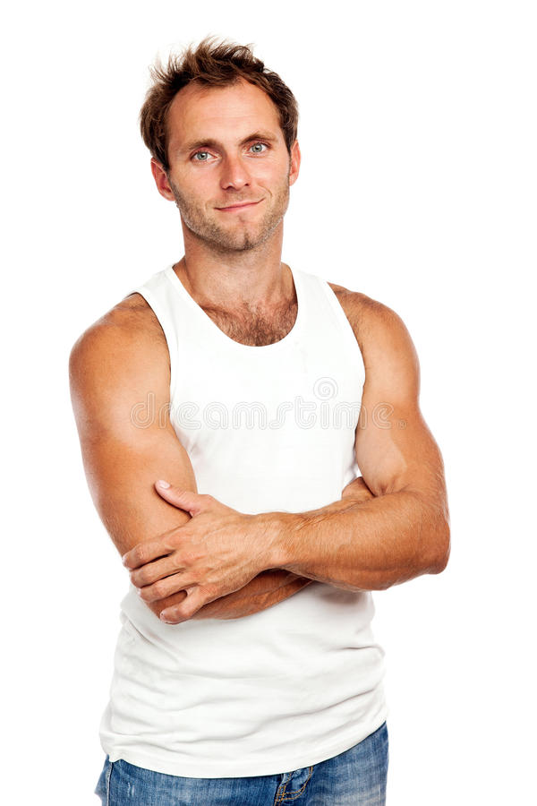 Handsome young man standing with arms crossed stock photos