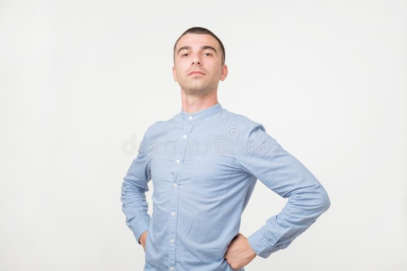 Handsome young man standing like a super hero royalty free stock photography