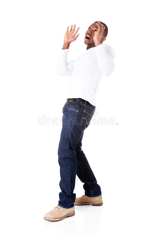 Handsome young man standing, scared. royalty free stock photo
