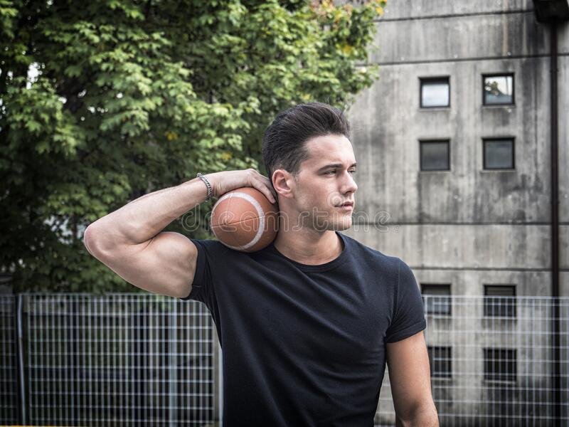 Man with American football ball royalty free stock photo