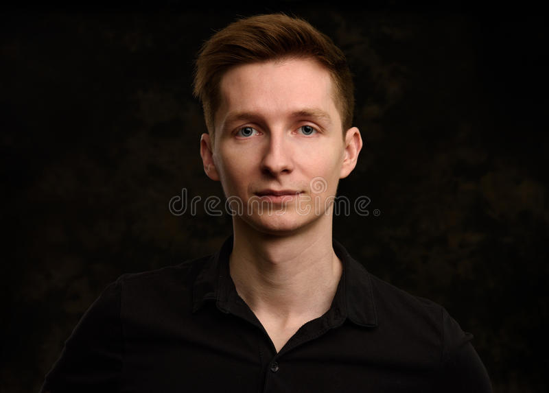 Handsome young man studio portrait royalty free stock image