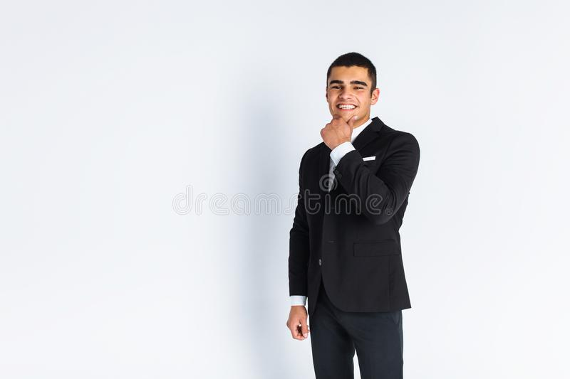 Handsome young man in a stylish suit, posing on a white background isolated stock photos