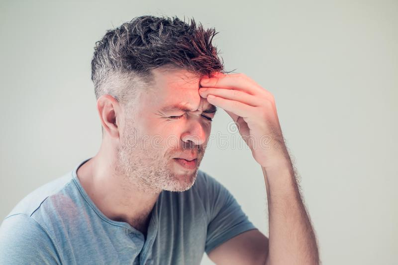 Handsome young man suffering from headache stock photos