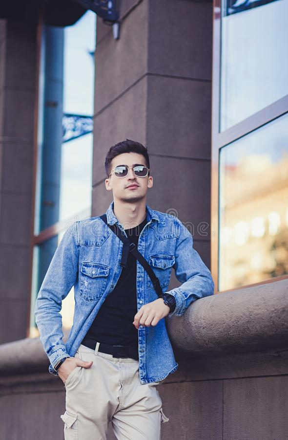 Handsome young man in sunglasses stock photos