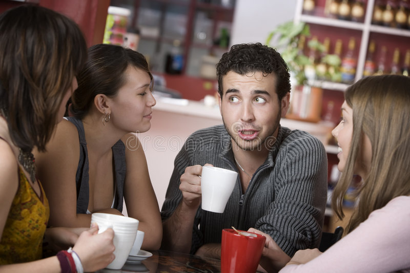 Handsome Young Man Surrounded by Women royalty free stock photography