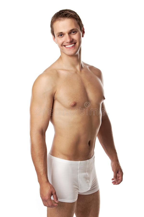 Handsome young man in underwear against white stock photos